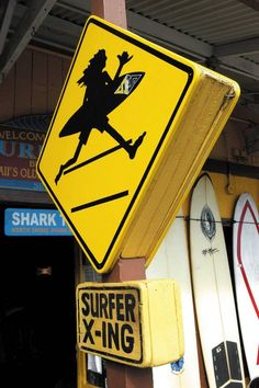 Watch out for surfers crossing the street in historic Haleiwa Town, found on Oahu's famed North Shore.    Have you ever been to Haleiwa Town?