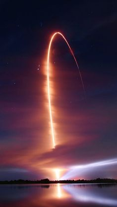 This graceful arc traces an Atlas V rocket climbing through Thursday's early morning skies over Cape Canaveral's Air Force Base in Florida - USA