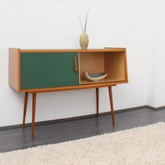 Wooden and Green Sideboard | 1950s #pin_it @mundodascasas See more here: www.mundodascasas.com.br