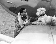 F/Sgt James Hyde, RAF Spitfire fighter pilot killed in action 25 Sep 1944, and his pet dog Dingo. Hyde took off with 132 Sqdn at 1525hrs tasked with providing aerial cover during the battle of Arnhem. Hyde was Killed in dog fight over Nijmegen his Spitfire IXE, PL316 one of four shot down by Jagdkorps II, JG26. Service number 1391841, the son of Joseph and Millicent Hyde, of San Juan, Trinidad, he is buried in Jonkerbos War Cemetery, Holland.