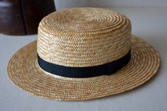 A boat hat is a summer hat which is usually low, altho not as low as a porkpie. It got a flat top like a top hat.