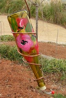 DIY Hummingbird Feeder.. Gahh! I have plenty of wine bottle! If I only had the talent to decorate them?