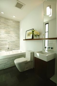Like the long skinny shelf across the mirror, plus the stone feature wall.