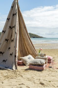 Tee pee on the beach, Indian summer style. cushions and flowing linen fabrics for magical memories