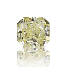 #Carat, #Sothebys, #Diamond, #Auction, #Jewelry, #Bling, #GIA, #CanaryDiamond, #EngagementRing, #DiamondRing, #YellowDiamonds, #ColoredDiamonds 0.61ct Natural light yellow diamond. A nice radiant shaped stone with very good VS1 clarity and nice yellow color. Certified natural by our in house gemologist (printed report supplied upon request).