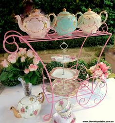 pretty pink serving cart with teapots