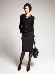 Love the shrunken cardi with the dark skirt. Very sophisticated.