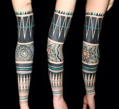 http://tattooideas247.com/wp-content/uploads/2014/10/Black-Green-Tribal-Tattoo.jpg Black & Green Tribal Tattoo #ArmTattoo, #BlackAndGreenTattoo, #SleeveTattoo, #TattooIdea