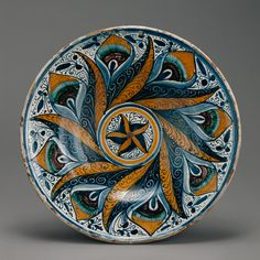 Dish with a Peacock Feather Pattern; Unknown; Deruta (probably), Italy; about 1470 - 1500; Tin-glazed earthenware; 6.4 × 39.1 cm (2 1/2 × 15 3/8 in.); 84.DE.103