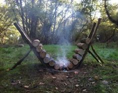 Ingenious way to keep a fire going all night, and not have to get up to stoke it. Now I have seen this done several times, but never actually tried it. As long as the supports don't catch on fire, then you are golden! #campfire #camping #outdoors
