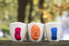 "This set of 3 climbing mugs is the perfect tool to increase your grip strength while having your morning cup of coffee! This set of 3 mugs includes one of each of our 3 different climbing holds and will allow you to have quite a lot of variety when choosing your morning ""route"". Mugs 1"