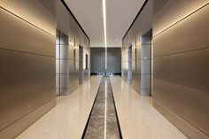 LEVELe Wall System with Float panels and custom panels shown in Stainless Steel with Satin finish; elevator doors shown in Stainless Steel with Mirror finish at Dulles Station, Herndon, Virginia