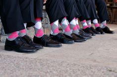 A pop of pink! Matching grrom and groomsmen argyle socks. Photos by Jennifer Bowen Photography | via junebugweddings.com