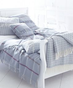 Soft blue grey open check throw and fringed cushions
