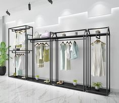 Golden clothes shelf clothing store in the island frame double sided women's clothing store bag display rack floor double row. Hanging Clothes Racks, Clothes Shelves, Clothing Store Interior, Clothing Store Displays, Showroom Interior Design, Boutique Interior, Womens Clothing Stores, Women's Clothing, Bag Display