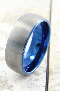 Mens tungsten carbide wedding band with beautiful blue interior. The top of the ring has a silver brush finish!