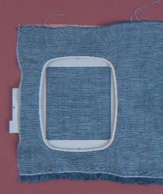 Use a dedicated machine-embroidery hoop or a third-party hoop that will fit easily under your presser foot.