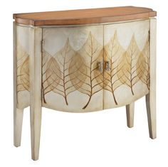 This one of a kind accent cabinet brings the beauty of the outdoors to the inside. Delicate leaf patterns are complemented by a metallic finish and a floating wood top. - Materials: 80% MDF, 20% Nan M