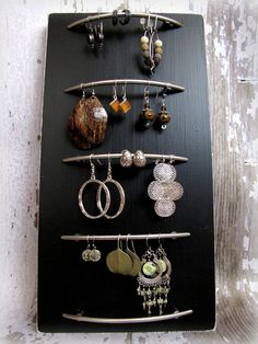 This is awesome! And I need one!  Simple cabinet hardware mounted onto a walnut coloured piece of shelving!  I CAN do this.