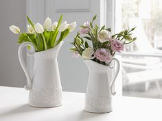 Hand-decorated jug vases with a slightly distressed glaze finish and paisley pattern detail. These pretty, white vases will add a French country feel to the home this spring. Shop in store, or online at Brissi.com #countrykitchen #frenchcountry