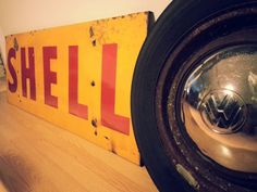 Shell Enamel Sign & Volkswagen wheel