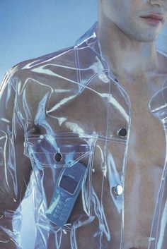 Clear plastic men's collared shirt with silver snap closures.. DIY the look yourself: http://mjtrends.com/pins.php?name=clear-vinyl-material-for-shirt