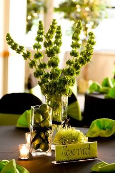 Those are gorgeous flowers.    love bells of ireland centerpiece