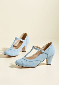 Pretty Little Hire Heel in Ice | Mod Retro Vintage Heels | ModCloth.com Got a secret, can you keep it? These pastel blue heels you'll crave! Better wear 'em, these'll wow 'em - so much style their perforations gave. Their T-straps and golden hardware will elevate your look. You're sure to get the job, yes, these matte pumps are all it took!