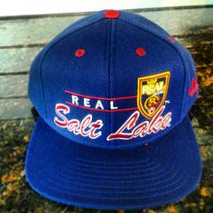 848f25eac40 Cursive blue snapback flat brim  24. Colors available  As shown. One size. Real  Salt Lake Team Store · Hats Beanies