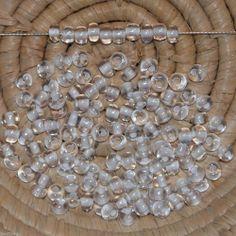 Lot 125 perles de rocaille (cal.5 / 4,5 mm) cristal trou coloré blanc