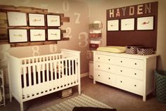 Baby Boy's Aviation Nursery - love the rustic wood panels and the fun accents!