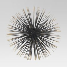 Add a flash of mid-century modern design to your wall with the Sea Urchin Decorative Wall Sculpture from Project 62™. The solid black center shifts to gold in a subtle ombre that brings the perfect amount of shine. Living room, family room or entryway, friends and family will be surprised and delighted to see this exciting wall art. <br><br>1962 was a big year. Modernist design hit its peak and moved into homes across the country. And in Minnesota, Target was born &md...