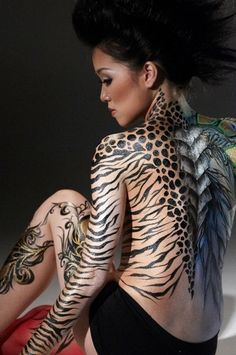 Different animal print back tattoo.