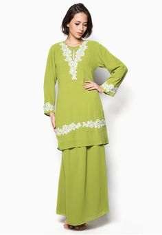 Embellished Baju Kurung from Aqeela Muslimah Wear in Green Delightfully adorned with floral embroidery and bead embellishments, this lovely baju kurung by Aqeela Muslimah Wear features a timeless, classic silhouette. Look absolutely demure yet alluring in this stunning number.  Top  - Polyblend - Rou... #bajukurung #bajukurungmoden