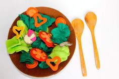 Felt Salad by comiditas on Etsy  Any sort of fruit/vegetable play food that's cloth.   Avery has some that I made, but it's minimal, and I won't have time to make anything else in the near future.