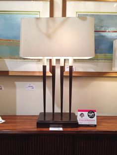 The Four Torches Lamp by John-Richard is mid-century inspired. The four spindles are cast out of brass and it has a brass base. The lamp is large in scale so it makes a big visual statement, and it would work well on a desk, beside table or console.