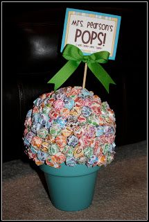 A flower pot, styrafoam ball, and dum dums....voila! Cute to put on a teacher desk or small group table as a student incentive!