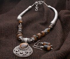 Tiger Eye #Necklace with Earrings  Add an ethnic quotient to your look with this German #Silver and semi precious #stones set.