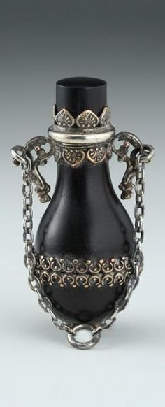 c.1840 LIGNUM VITAE SCENT PERFUME BOTTLE IN ORNATE PLATED MOUNT