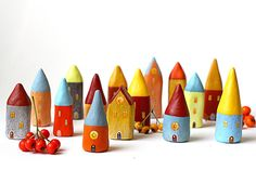 Little Home No 486 Little clay house orange with light by rodica.  Seriously cute.