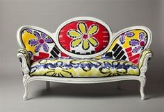 Recycled couch with hand painted upholstry!  Wish I had the guts to do this with an old one that I have!
