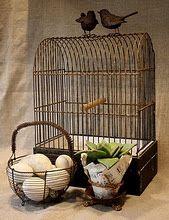 Birds...Love the basket of CHICKEN eggs sittin' next to it...