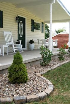 Young Nesters: Front Porch Landscaping; use river rock instead of mulch and don't have to replace