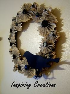 medallion wreath made of book pages. Tutorial at Inspiring Creations.