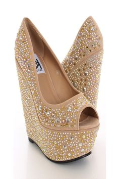 These elegant and stylish with these high fashion platform wedges! With its classic slingback design and sparkle its sure to make any outfit runway ready! Make sure you add these to your closet, it definitely is a must have! Featuring peep toe, rhinestone studded threw out, faux suede, smooth lining, and cushioned footbed. Approximately 6 1/4 inch wedge and 2 1/4 inch platform.