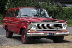 Sweet old red Wagoneer in Germany.