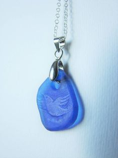 Necklace with a protective runic pendant-amulet from blue sea glass with hand engraved flying bird and bind runes. Sea Glass Necklace, Sea Glass Jewelry, Unique Necklaces, Hand Engraving, Runes, Necklace Lengths, The Help, Purple, Blue