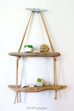 Learn how easy it is to make a DIY hanging rope shelf. It's the perfect nautical wall decor idea for the lake house or cottage! Learn how easy it is to make a DIY hanging rope shelf. It's the perfect nautical wall decor idea for the lake house or cottage! Driftwood Shelf, Painted Driftwood, Driftwood Projects, Driftwood Ideas, Decorating With Driftwood, Decorating With Nature, Driftwood Signs, Hanging Rope Shelves, Nifty Diy