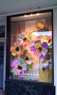 Window display for April- April Showers bring May flowers