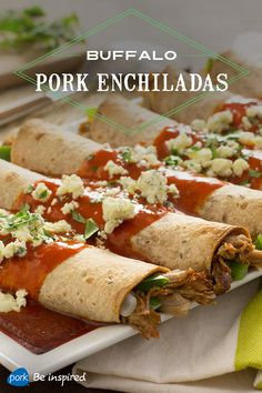 These buffalo-inspired enchiladas feature juicy pork tenderloin, whole wheat tortillas, celery, gorgonzola and a bold, spicy sauce. They can be made in a slow cooker and assembled at dinner time or frozen and reheated.